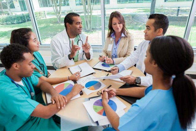 group of medical professionals review data