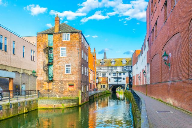 River Witham passes old wooden buildings in central Lincoln, England